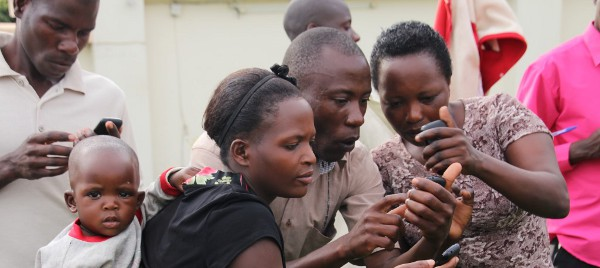 Group in Africa Amazed by Mobile Phone | engageSPARK