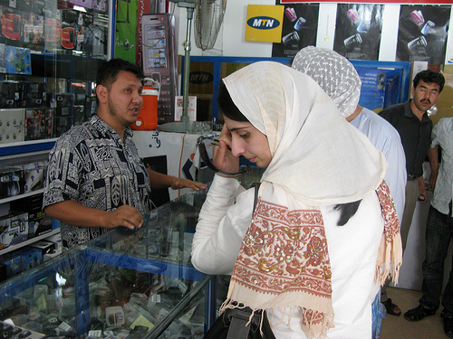 Women in mobile phone store